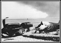 The remains of a Spitfire on a beach near Dunkirk